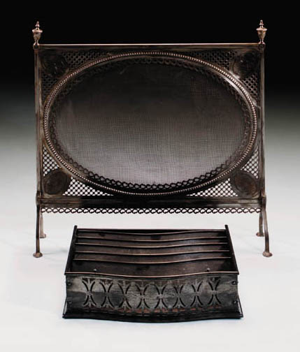 A polished steel firescreen, e