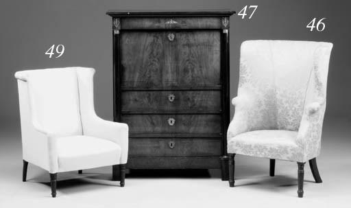 A mahogany wing armchair, 19th