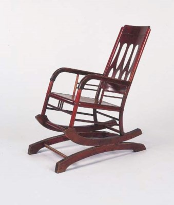 A red-stained bentwood rocking