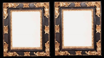 A pair of Italian ebonised and