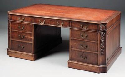 A mahogany partner's desk, lat