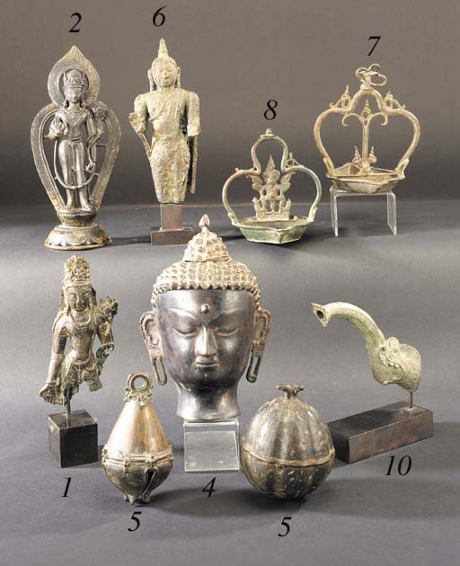 A group of six bronze lamps