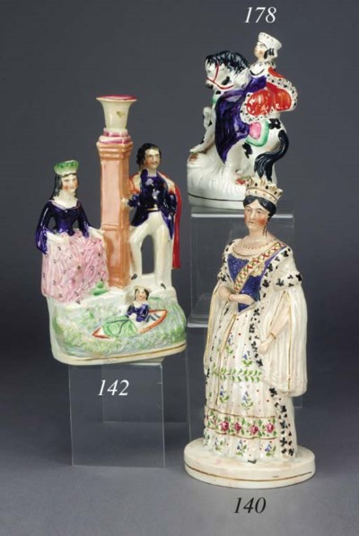 A CANDLESTICK GROUP OF VICTORI