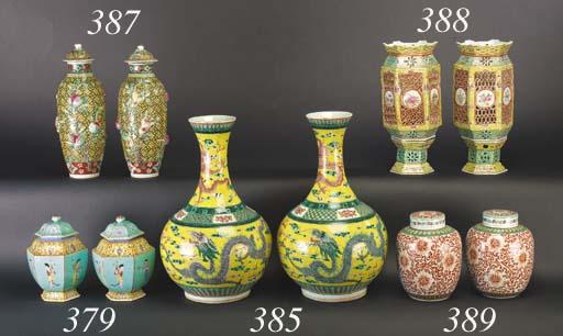 A pair of famille verte, yellow ground bottle vases