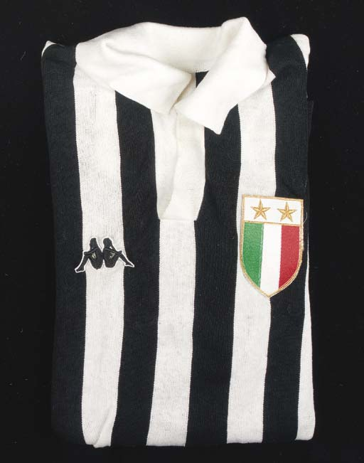 A black and white Juventus shirt, No.6, with v-neck collar and embroidered cloth badge
