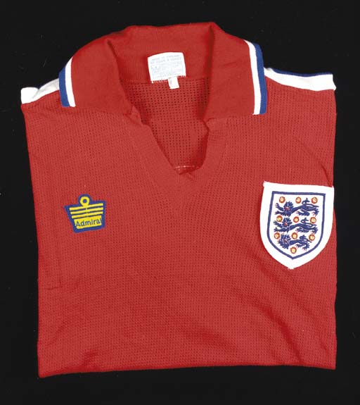 A red, white and blue Airtex England International short-sleeved shirt No. 2, with v-neck collar and embroidered badge