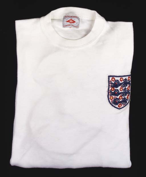 A white England International shirt, No.6, with crew-neck collar and embroidered cloth badge, the front and back with scorch marks