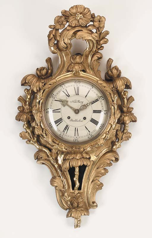 A Swedish carved giltwood striking wall clock, late 19th early 20th century