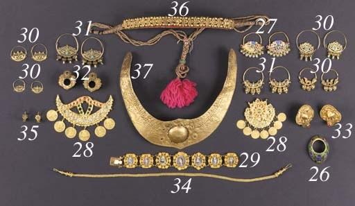 A Tibetan repousse gold neckla