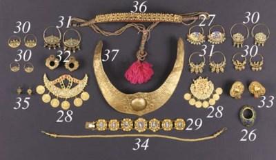 An Indonesian gold turben orna