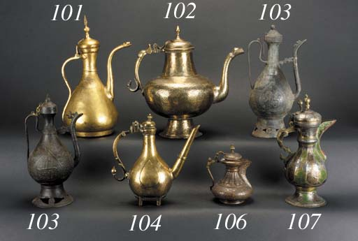 A Bokhara inlaid faceted brass ewer signed Mulla Hajji, dated 1223, early 19th Century