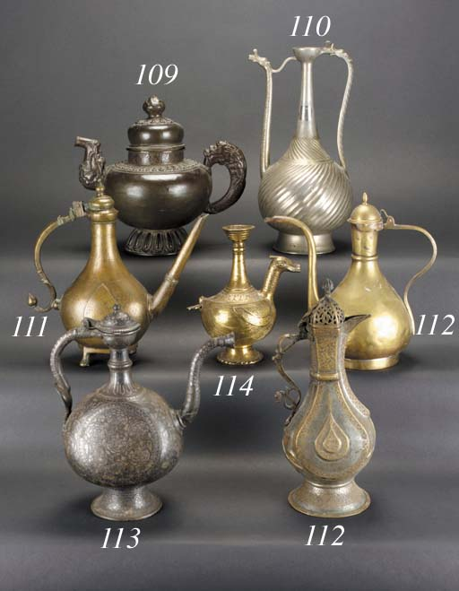 A Persian bronze ewer and hing