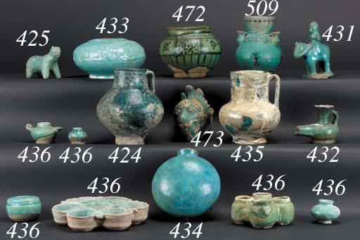 A Kashan turquoise glazed pottery flask