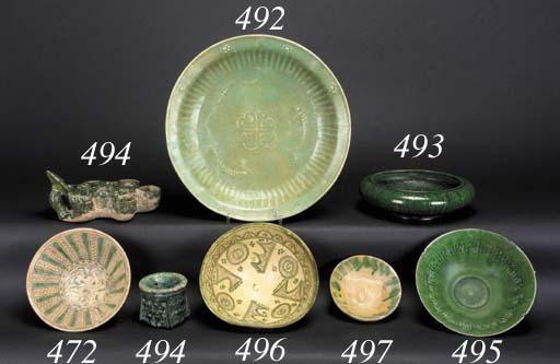 A Nishapur green glazed bowl
