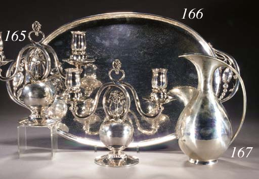 A PAIR OF METALWARE TWO-LIGHT