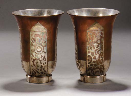 A PAIR OF COPPER AND SILVER-EN