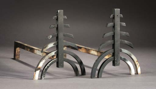 A PAIR OF BLACKENED IRON FIRED