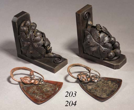 A PAIR OF WROUGHT-IRON BOOKEND