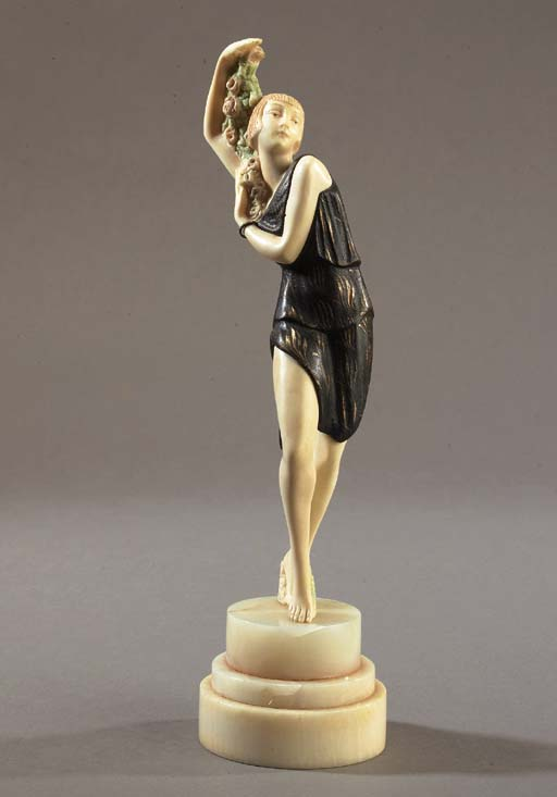 A PATINATED BRONZE AND IVORY F