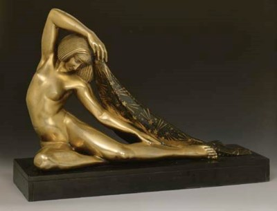 A PATINATED AND GILT BRONZE FI
