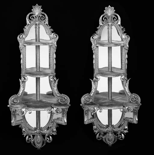 A pair of early Victorian giltwood corner shelves
