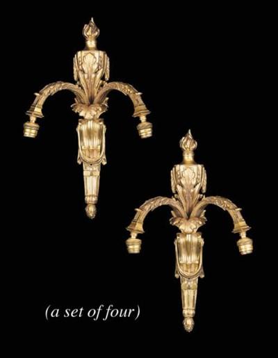 A set of four gilt bronze twin