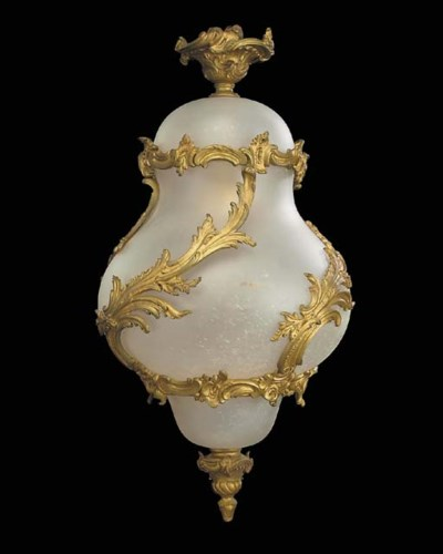 A gilt bronze mounted frosted