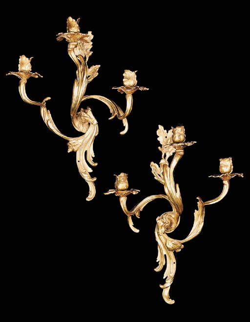 A set of four French gilt bron