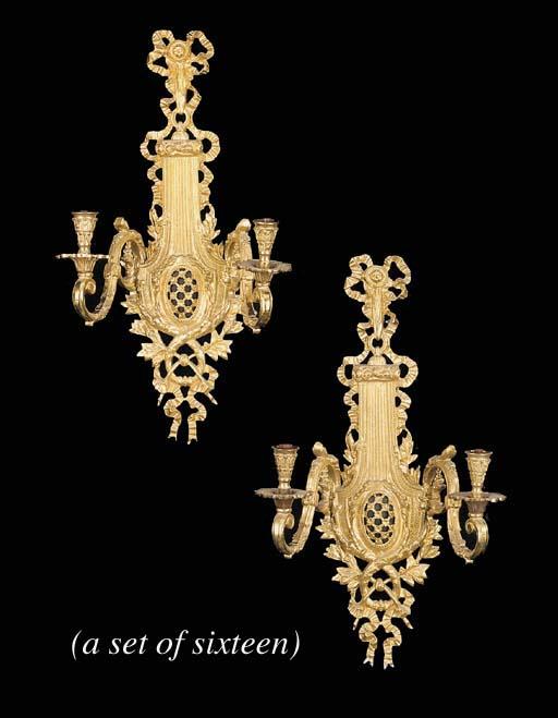 A set of sixteen gilt bronze t