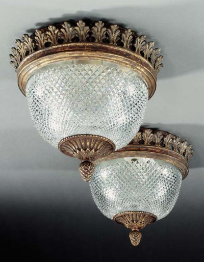 A pair of cut glass and gilt b