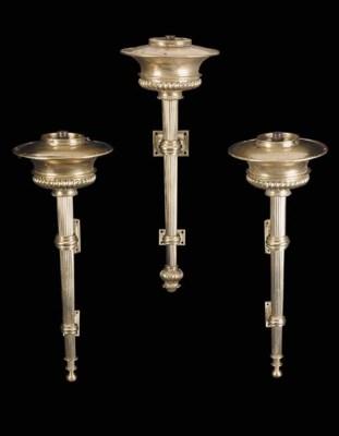 A pair of gilt brass torchere