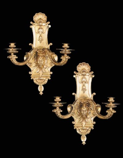 A pair of Regence style gilt b