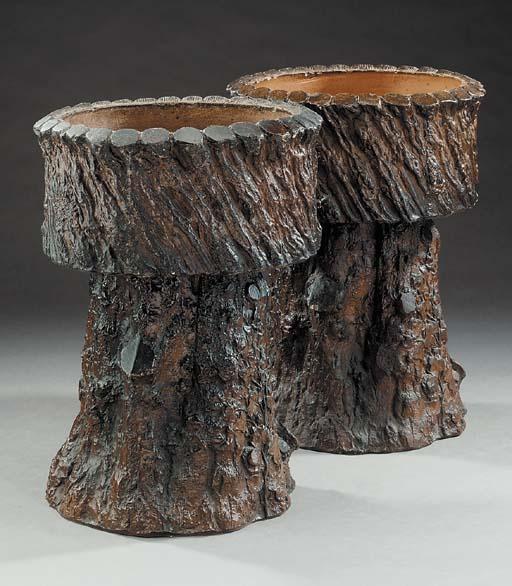 A pair of terracotta rustic ga