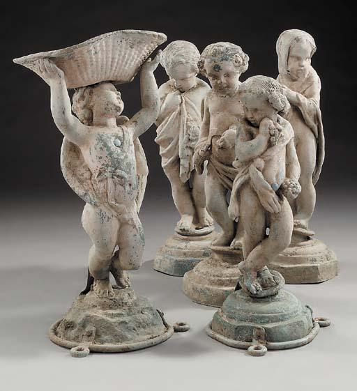A set of four lead cherubs rep
