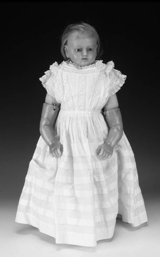 A poured wax child doll