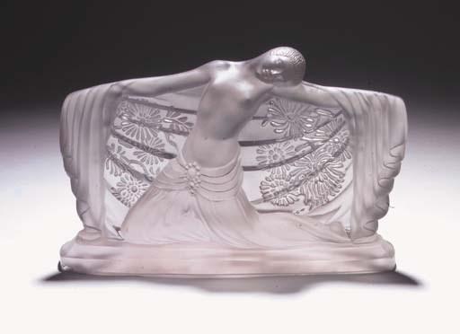 An Etling moulded glass figure