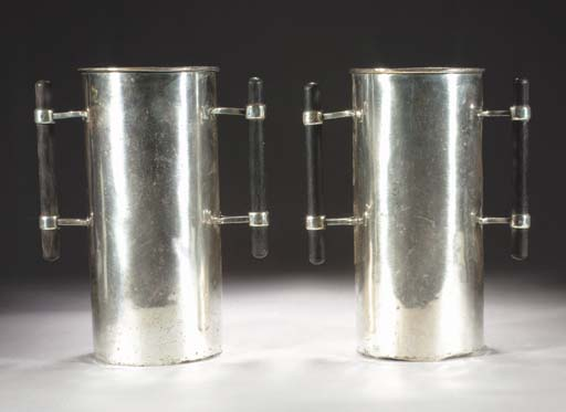 A pair of silvered metal bottl