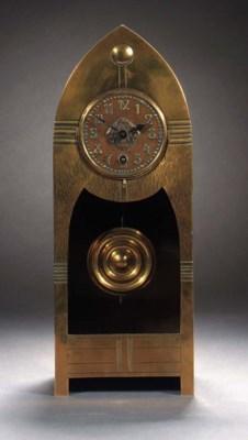 An Art Nouveau brass clock