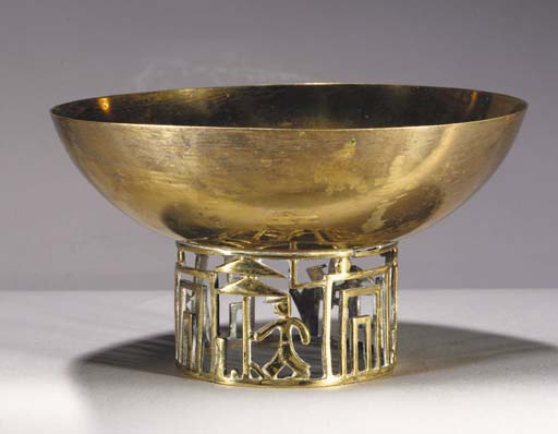 A brass bowl in the style of H