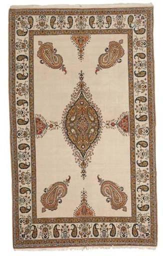 A fine part silk Qum rug