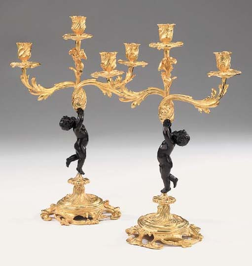 A pair of French gilt and patinated bronze three light candelabra, 20th century