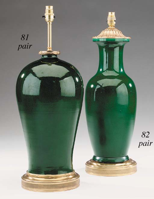 A pair of green-glaze ceramic vases, gilt metal mounted as table lamps, of recent manufacture