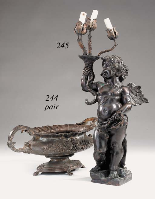 A pair of French cast iron jardinieres, late 19th century