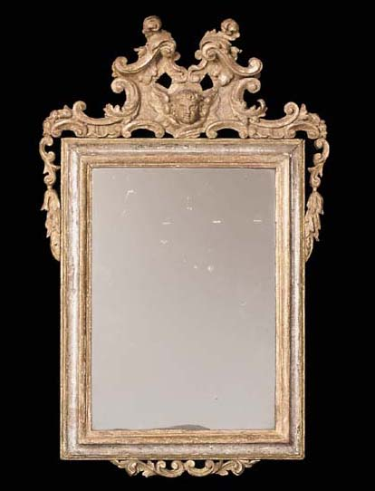 An Italian gilt composition and silvered mirror, early 18th century, parts later