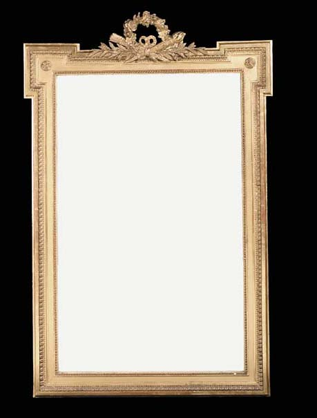 A Louis XVI carved giltwood overmantel mirror