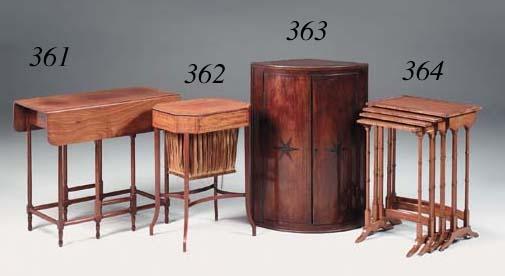 An Edwardian mahogany and ebony strung octagonal work table