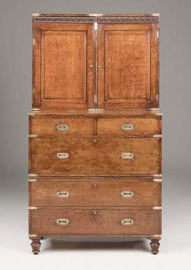 A Victorian oak and brass-bound military cabinet-on-chest