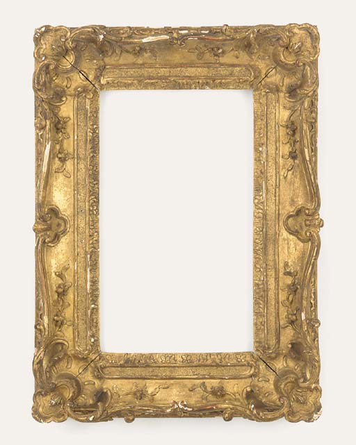 A French Louis XV carved and gilded oak frame, mid 18th century