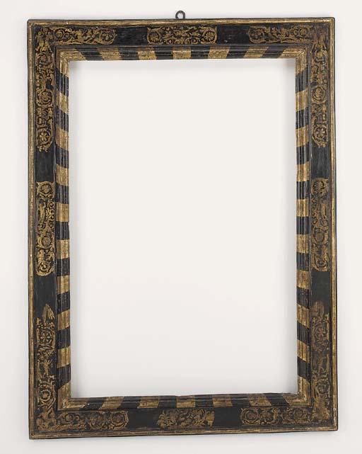 An Italian parcel-gilt and ebonised cassetta frame, 17th century
