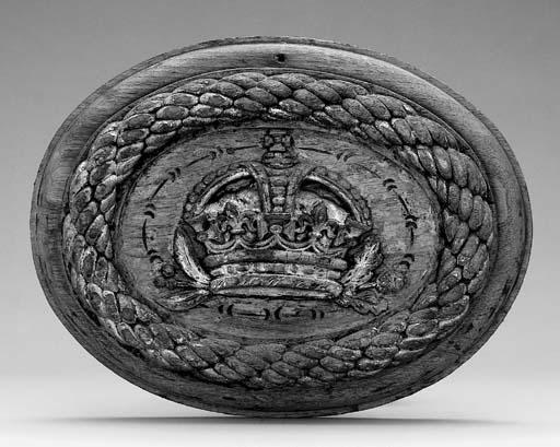A carved oak badge, believed t